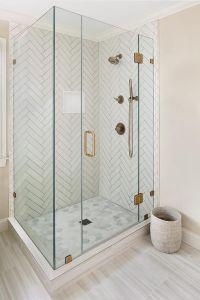 Master bathroom shower with white herringbone tiles and ...