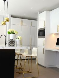 Black & white kitchen with brass and gold accessories ...