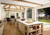 lovely open kitchen with rustic beams and wood floors ...
