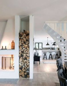 Cabin interior inspiration white and wood storage next to fireplace also rh pinterest