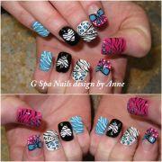 zebra cheetah bow nail design
