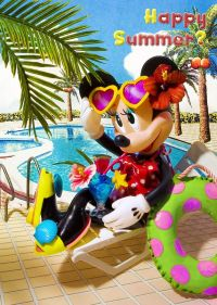 Minnie Mouse sitting on a lounge chair poolside and having ...