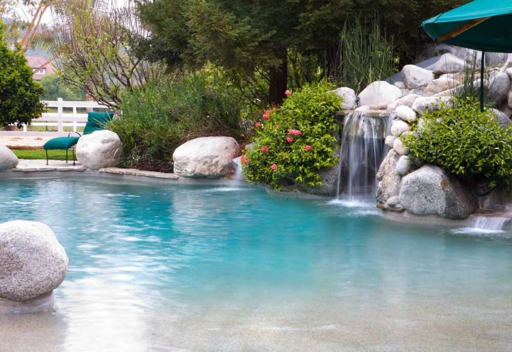 What Is A Beach Entry Swimming Pool  Backyard Escapes