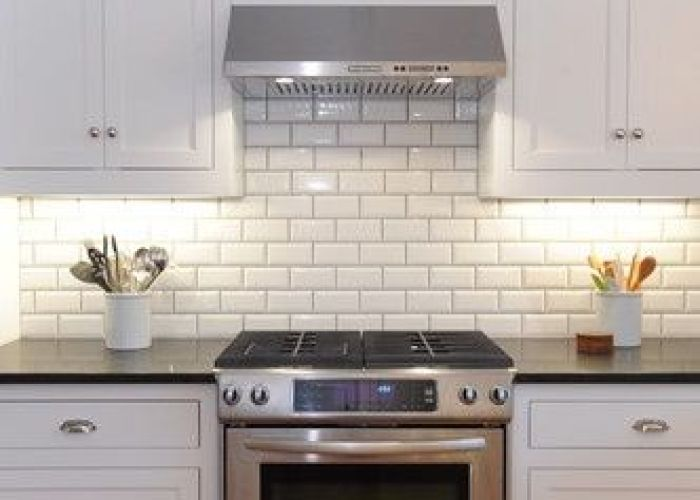 Beveled subway tile with grey grout also kitchens black granite countertops white glass front cabinets