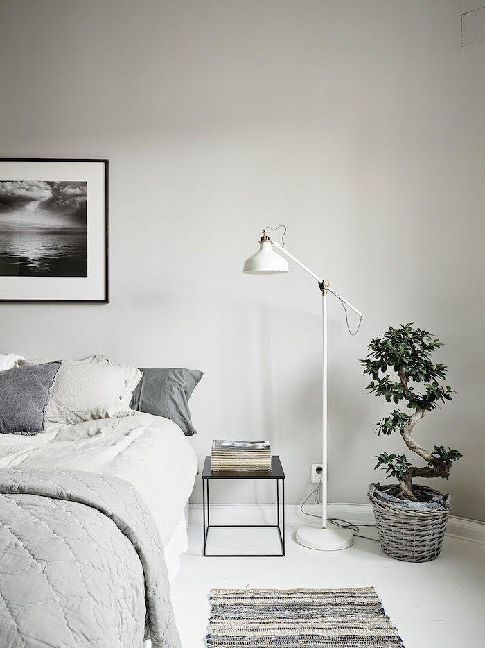 Bedroom pale grey bed linen white floor white floor