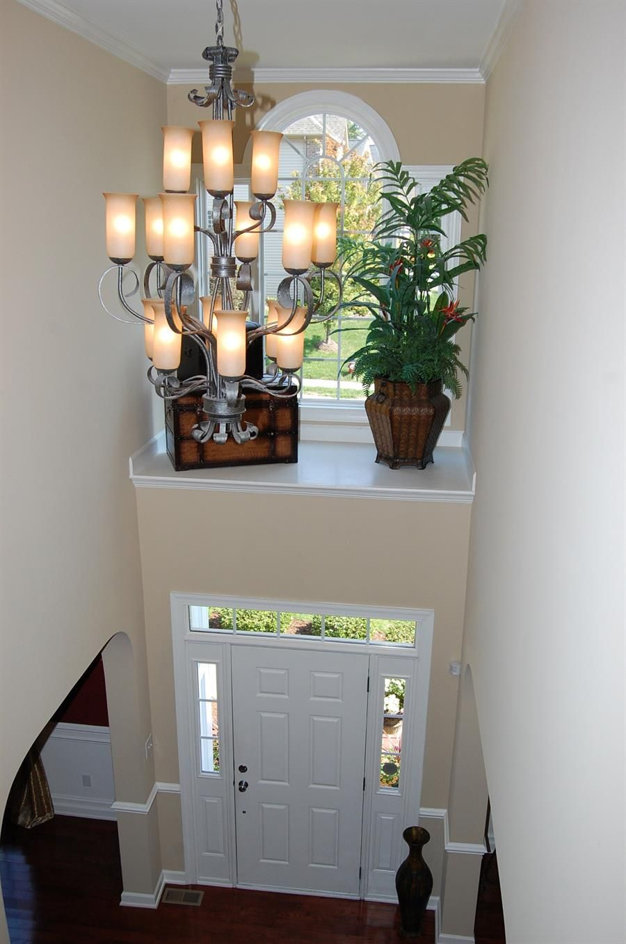 two story foyer with shelf above door with window. What