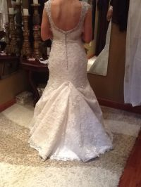 over bustle with a mermaid style lace wedding gown ...
