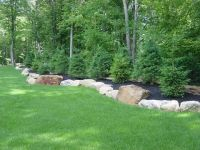 Berm Landscaping Ideas   berm with large boulders ...