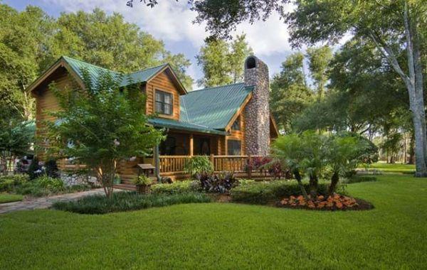 log cabin home and landscape