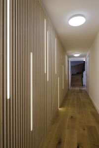 LED lighting dissecting a wall of plywood strips in ...