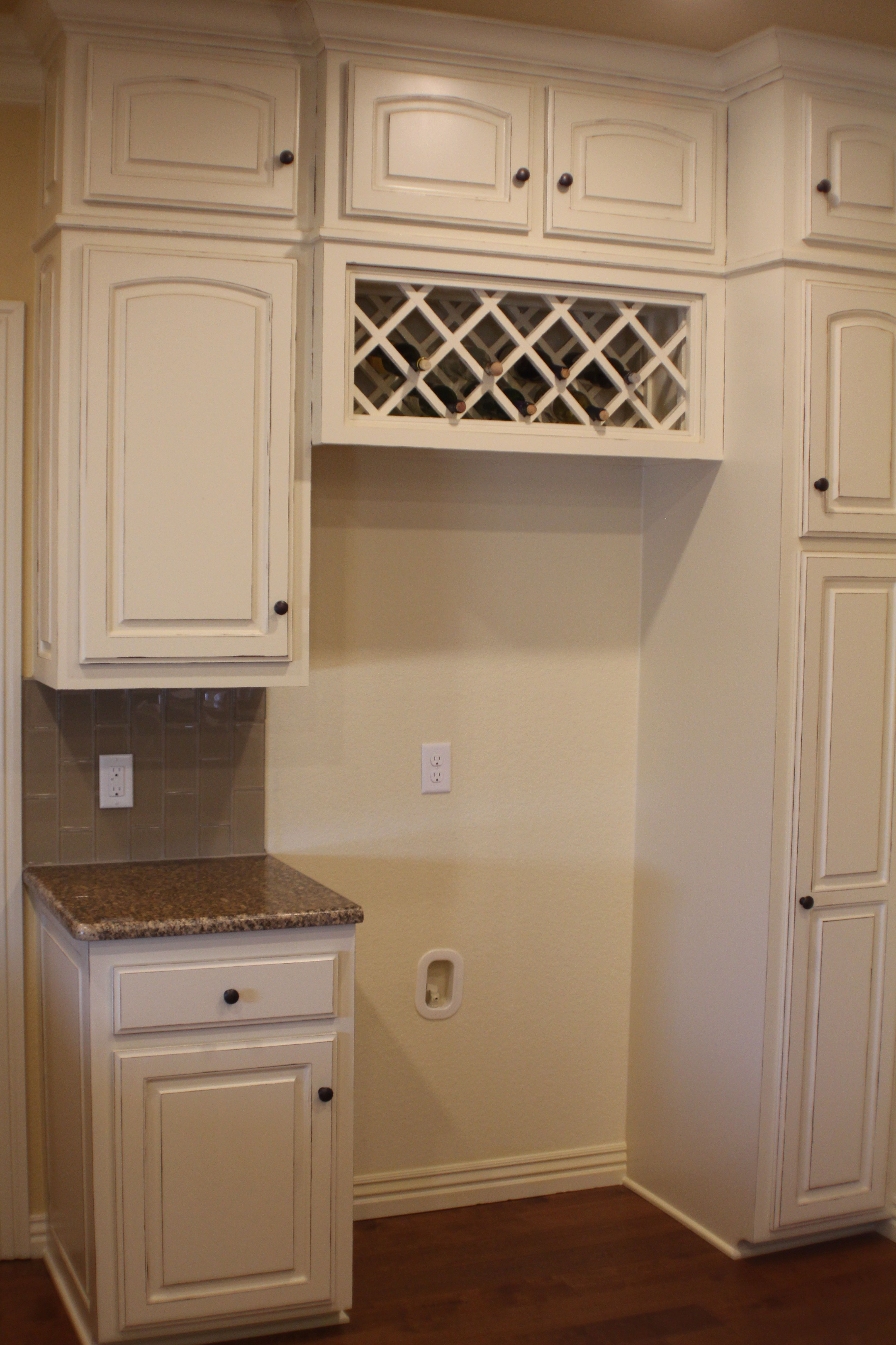 built in wine rack above fridge...still on the fence about