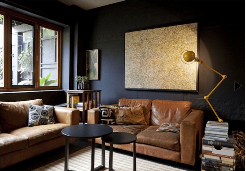 Melbourne living room with great contrast of dark walls