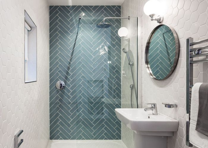 Ocean glass tile large installed in herringbone pattern shower like that the has an accent wall also hexagon du  bia po ysk aran acje sandes bathrooms pinterest