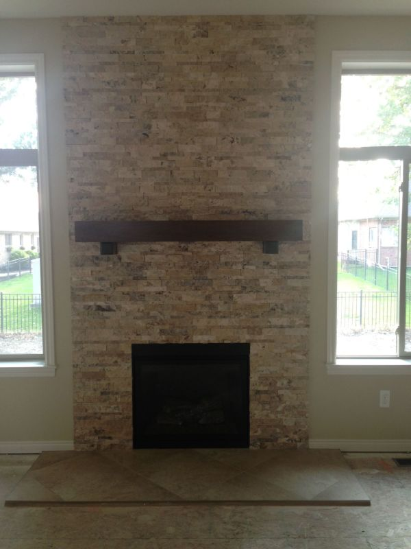Travertine Stacked Stone Fireplace -over