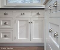 Cabinet hardware: cup pulls on the drawers is a must