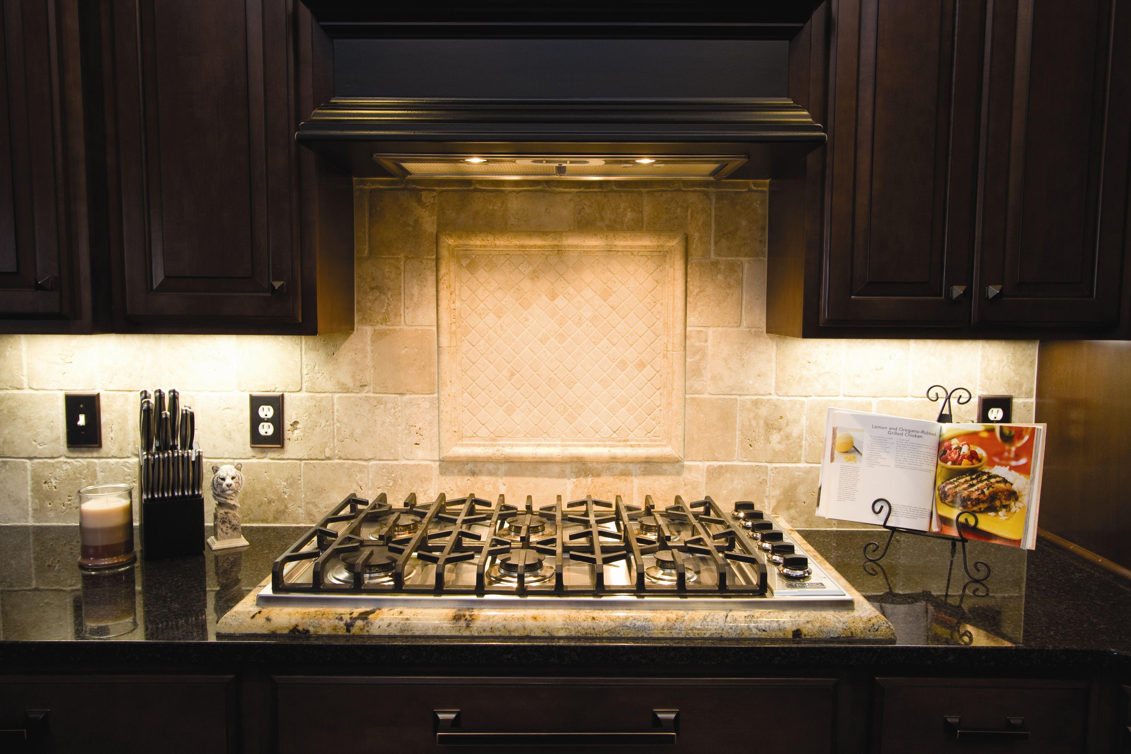natural stone backsplash kitchen home depot ceiling light fixtures with framed medallion granite