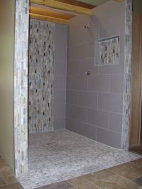 Doorless curbless tile shower with river rock floor and ...