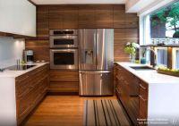 Walnut wood kitchen cupboards, sleek handles, inset sink ...