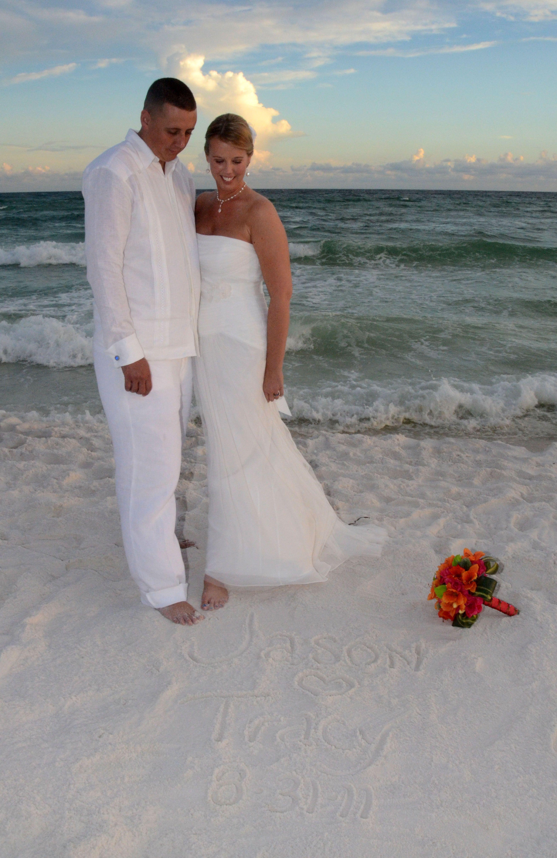 Beach wedding bride and groom, wearing a Debra Torres