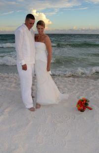 Beach wedding bride and groom, wearing a Debra Torres ...