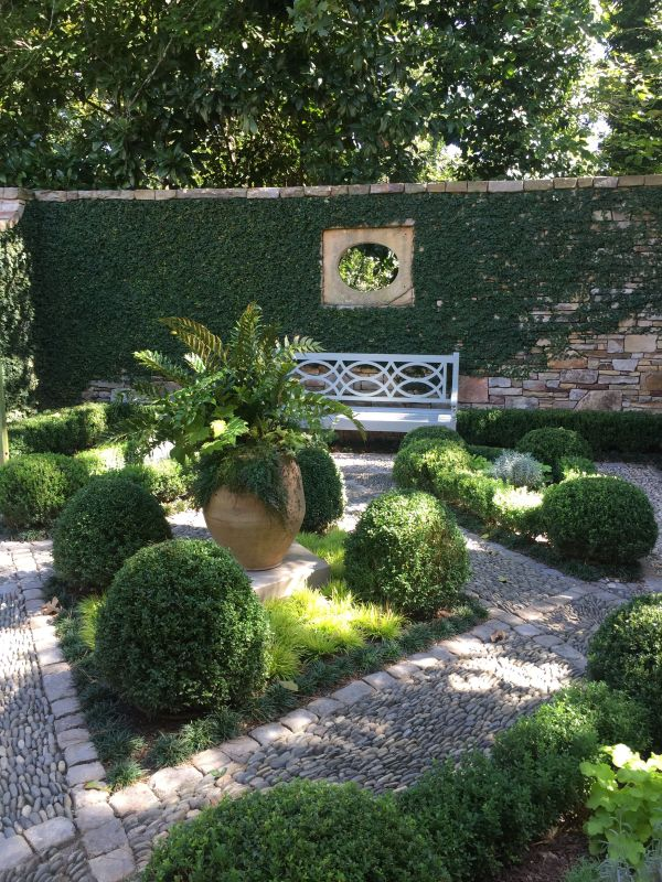 walled courtyard garden with boxwood