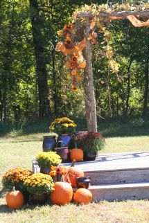 Rustic Country Fall Wedding Arch. Decorated With