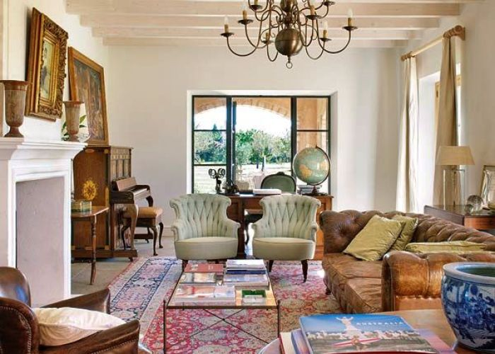 Tan leather chesterfield in traditional living room with large red oriental rug also colourpop peace out inexpensive delights pinterest