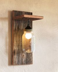 This mason jar light fixture is the perfect wall sconce ...