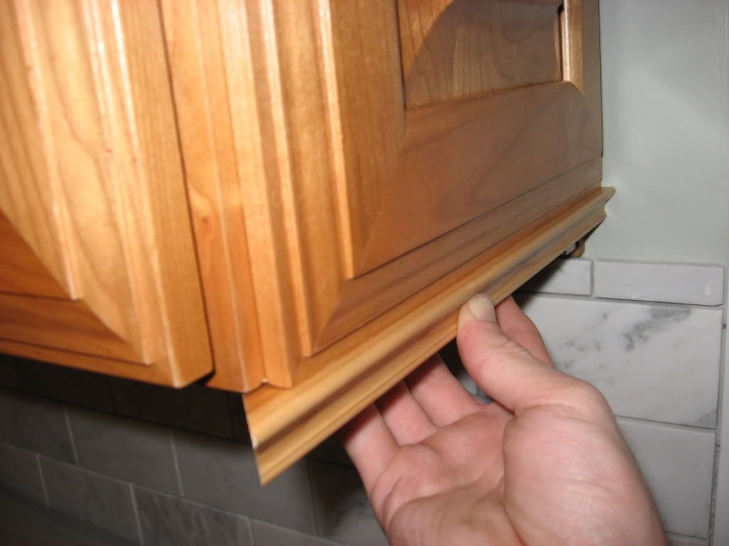 kitchen cabinet trim installation rubber mat add molding to hide under lights and outlets