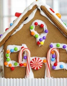 Gingerbread cookie house dotted with colorful candy holiday bakingchristmas also christmas joy rh nz pinterest