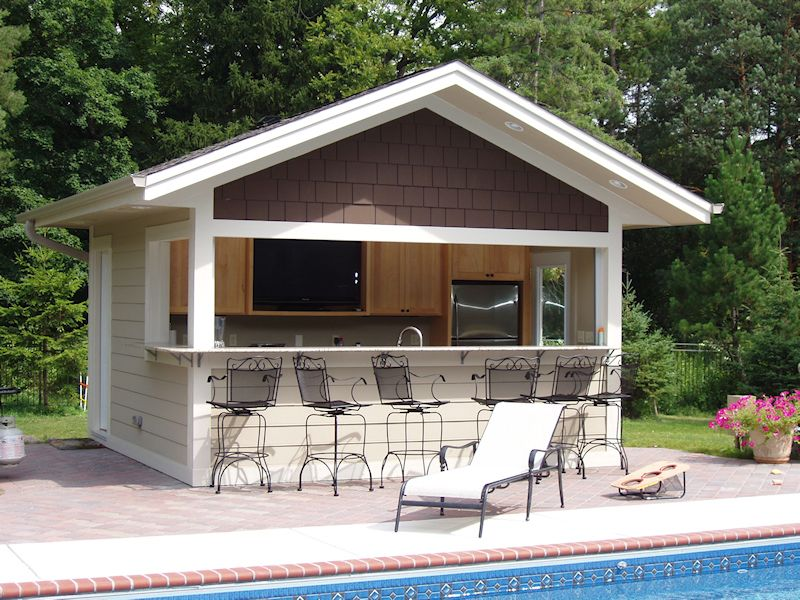 Build A Bar Into The Side Of Your Pool House Where Family Can Eat