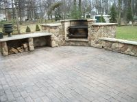 Cobblestone stamped concrete patio with outdoor fireplace ...