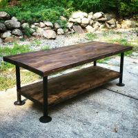 Industrial style wood coffee table with steel pipe legs ...
