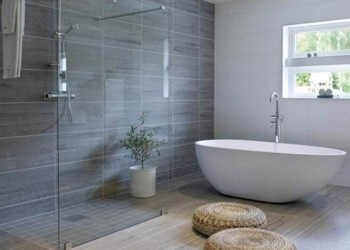 The three tile coverings work together nicely  think also beautiful shower and freestanding tub une grande salle de bains avec douche   italienne et baignoire