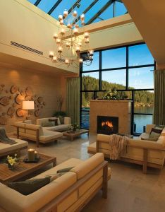 Beautiful ceiling full of skylights fireplace surrounded by window lake view chandelier also living under the sky can  live here please pinterest rh