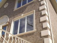 Home with #precast concrete window surrounds, quoins and ...
