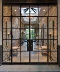Steel doors & windows add a subtle and elegant touch to a ...