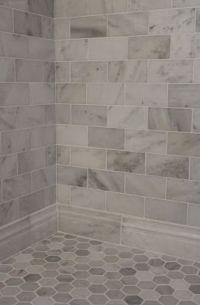 Carrera marble subway tiles and honed marble hexagon floor ...