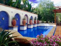 Modern Spanish Sevilla style backyard with a pool spa ...