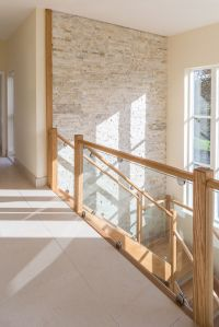 Beautiful hallway, stairs and landing. Cream quartzite