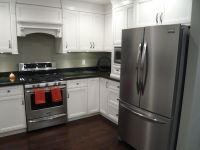 White Cabinets, Black Granite, Dark Hardwood, Stainless ...