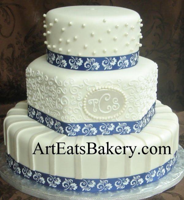 Three Tier White Fondant And Hexagon Wedding Cake