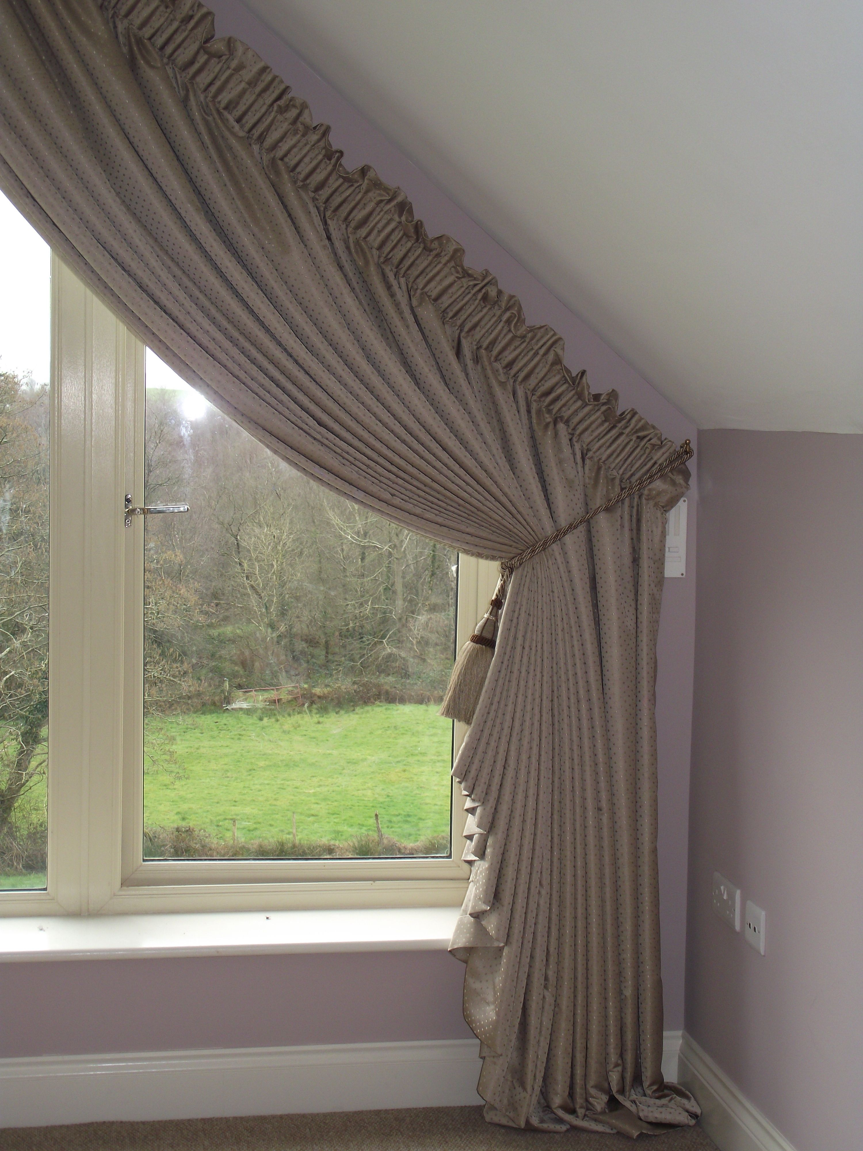Shaped curtains on a triangular window made by Gers