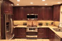 Shaker door style custom cherry kitchen cabinets with a ...