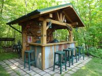 Rustic outdoor bar with corrugated steel accents
