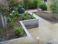 Raised concrete planter bed matches level of steps ...