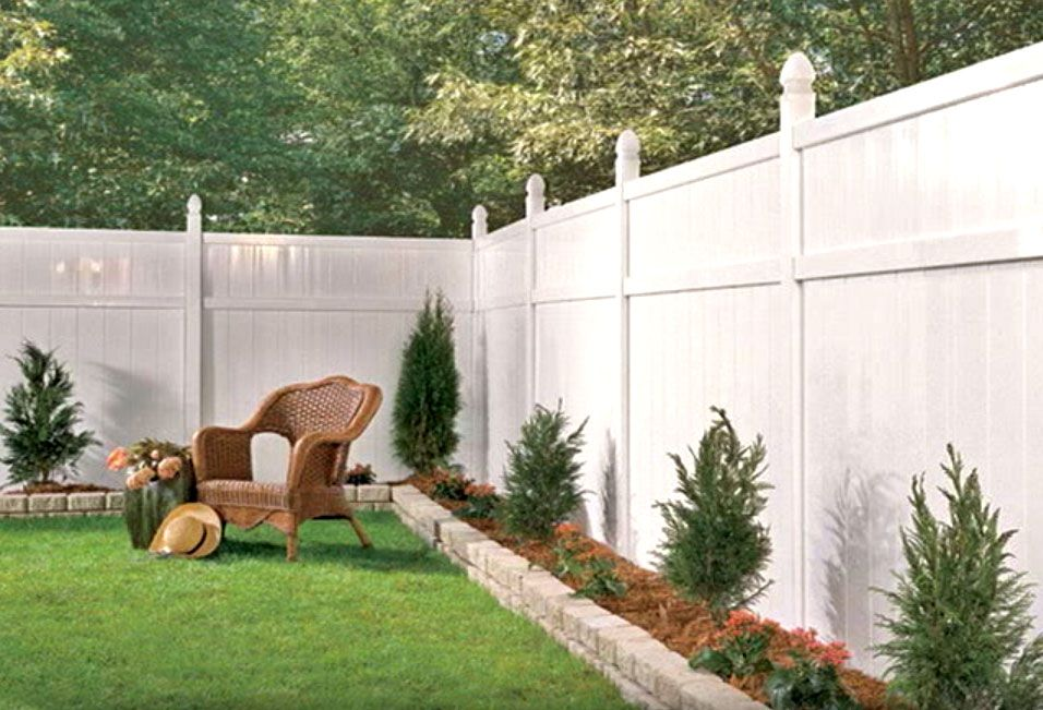 White vinyl fence with a small raised border Very cute