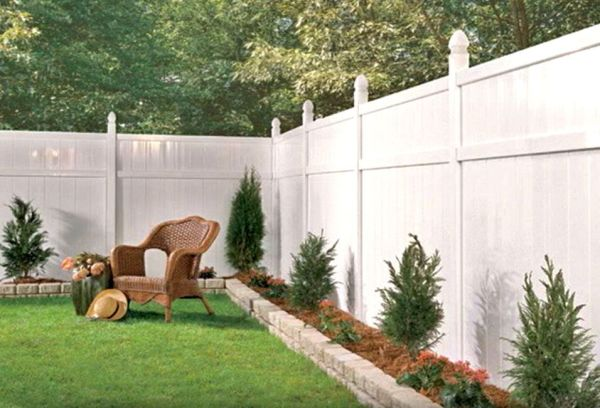 white vinyl fence with small