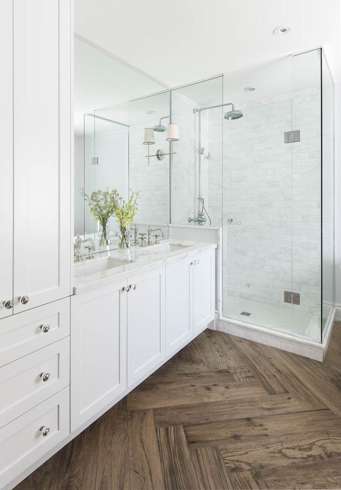 Master bathroom with herringbone wood floor marble shower
