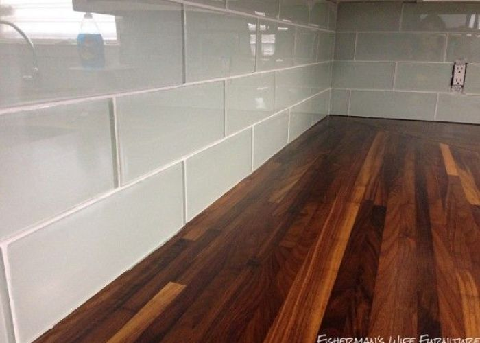 Small white kitchen makeover with built in fridge enclosure glass subway tile also